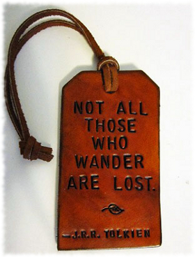 Picture of a luggage tag with a quote about Aragorn from Lord Of The Rings saying Not all those who wander are lost.