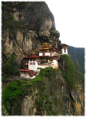 Picture of a Buddhist monastery on the side of a mountain.