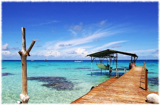 Picture of a dock in Fakarava Tahiti showing boats in the water.