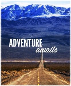 Picture of road to the mountains with caption saying Adventure Awaits