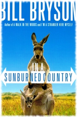 Picture of the book cover for In A Sunburned Country by Bill Bryson that shows a kangaroo and baby in Australia.