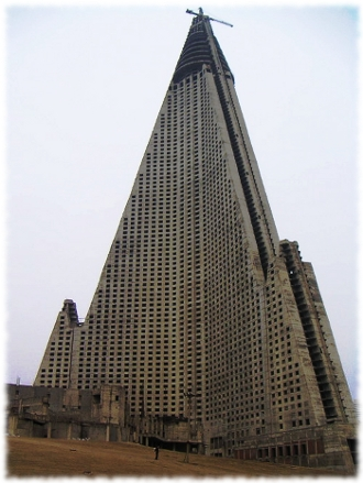 Picture of the worst building in the world the Ryugyong Hotel in North Korea.