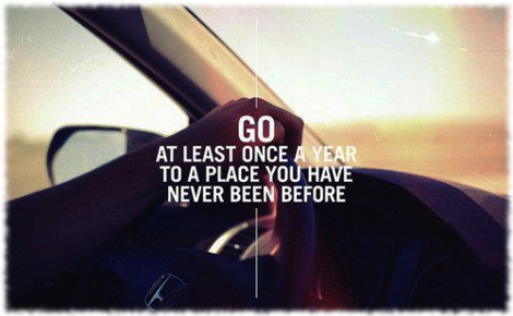 Picture that says Go at least once a year to a place you've never been before, and shows a closeup of the inside of a car during a road trip.